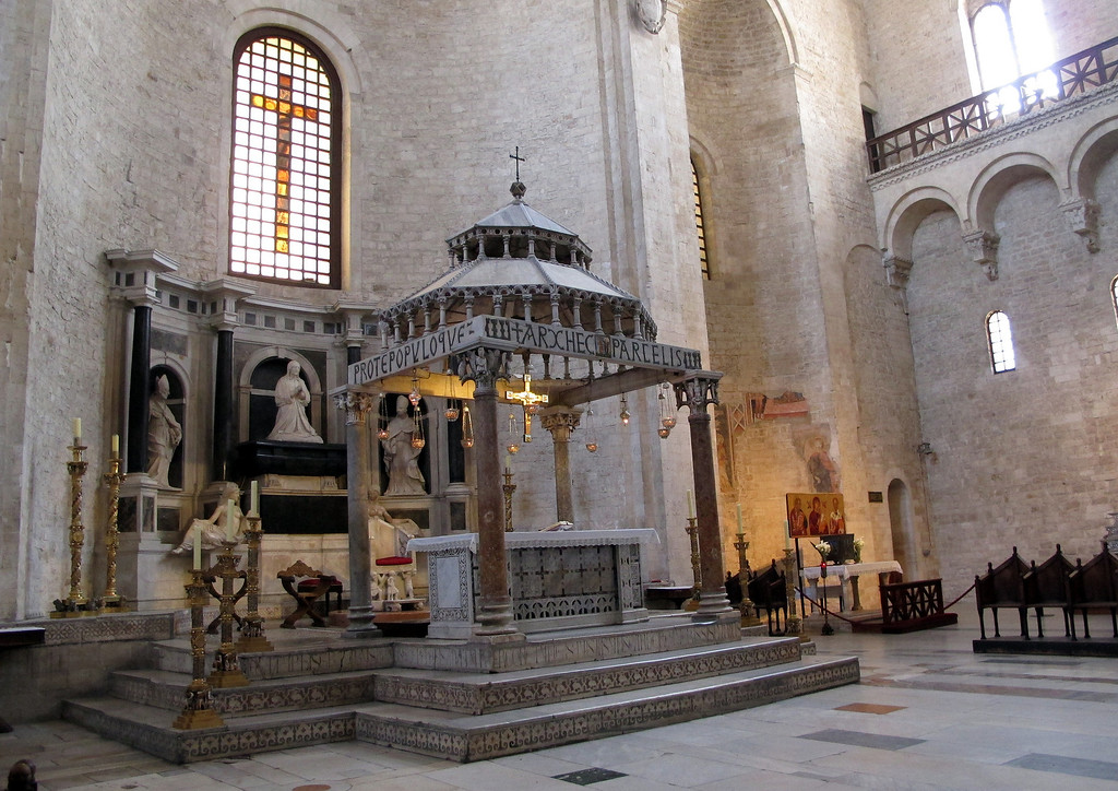 The famous canopy in St Nicolas' Cathedral, Bari.   The 'roof' of the canopy is stone but worked until it is translucent.