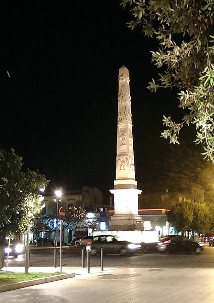 Evening in Lecce, the obelisk at the Porta Napoli.