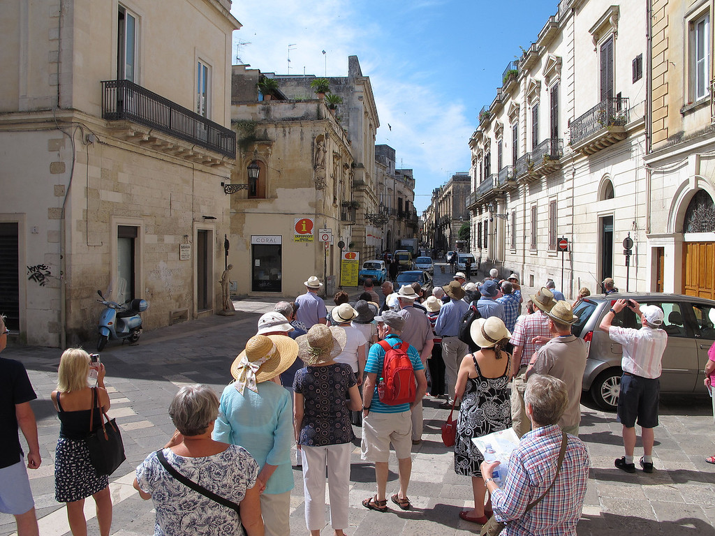 Our group (50 people) is taken on a tour round Lecce. We were each given a radio receiver so that the guide didn't need a flag/folder/hand in the air. It worked very well.