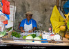 m328, Fig 7.1 / CO7: a food market scene in Panama where we can read the labels on the food. <br /> Choice 8 of 11<br /> <br /> B474EX Man at his produce post Penonome Public Market, Province of Cocle, Republic of Panama, Central America