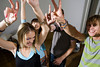 P11.16 / Student party / people dancing<br /> Choice 4 of 12<br /> <br /> Friends doing peace signs --- Image by © Image Source/Corbis