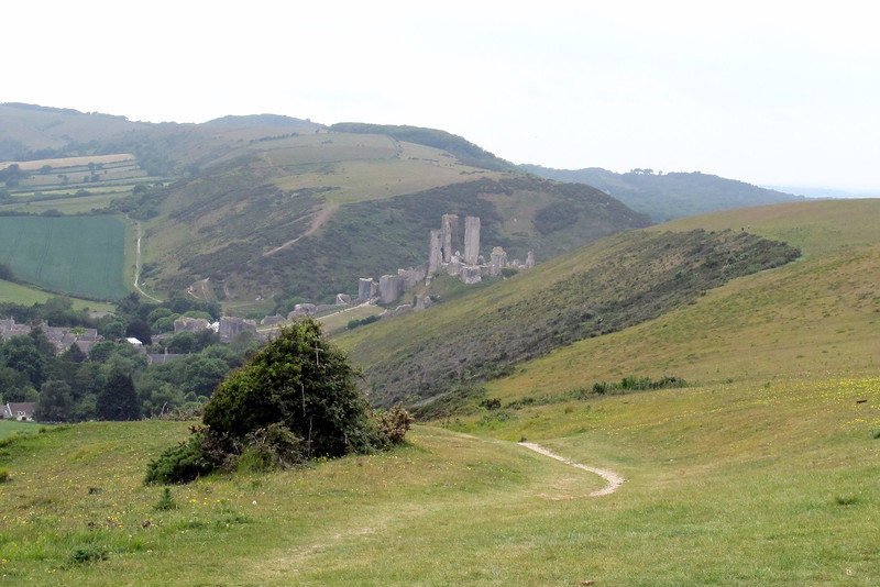The Castle nestles between the Purbeck Hills