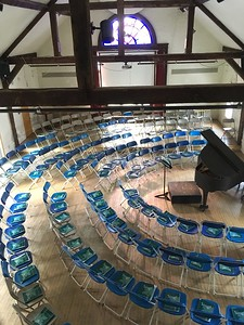 Wow!  New chairs instead of old wooden benches, all arranged and awaiting the evening Sing!   My senior year I lived in Old Girls, and liked this balcony view of the Assembly Hall. Sometimes I'd sit on a rafter, reading a book.