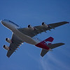 """The first Qantas Airbus A380 (VH-OQA s/n 014) flies just 500 feet above the """"Light aircraft"""" lane over North Rocks NSW on its approach to Kingsford Smith airport at 0845, 21st September 2008 after its maiden delivery flight from Toulouse. <br /> <br /> Mares' tails in the sky portend a storm.<br /> <br /> Nancy Bird Walton passed away peacefully in Tuesday, 13th January 2009. My lovely daughter, Felicity, gave me a signed copy of Nancy's book """"My God, It's a woman! for my birthday. Treasure."""