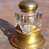 A cut crystal inkwell set in brass - perfect for a lady's writing desk.