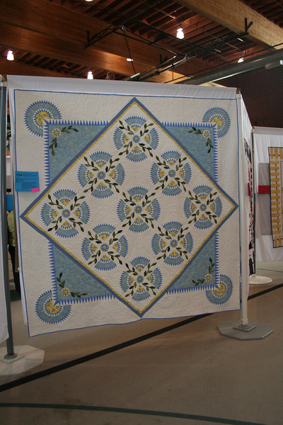 This was hand quilted, and original design.  IT was stunning in person