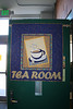 they had a tea room, and quilted a sign for the door.  You can't tell but the tea bag string hanging out of the copy hung loose and the paper on the end was quilted too and hung loose, it was cool