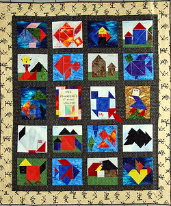 DSC_0371b. Lynn and Tracy made this quilt for a Laureate school fundraiser. It was pieced together (not printed on material) using tangrams from Mrs. Townsends 1st grade class. April 2009. Pictures of the kids' tangrams are elsewhere in this gallery.
