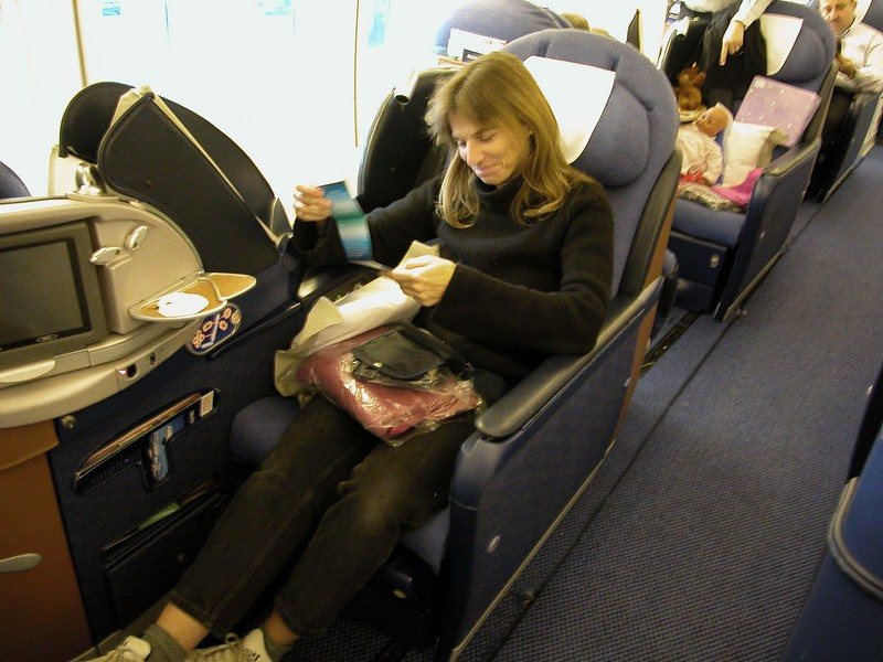 Janet settles into her seat on a British Airways flight to Mauritius.