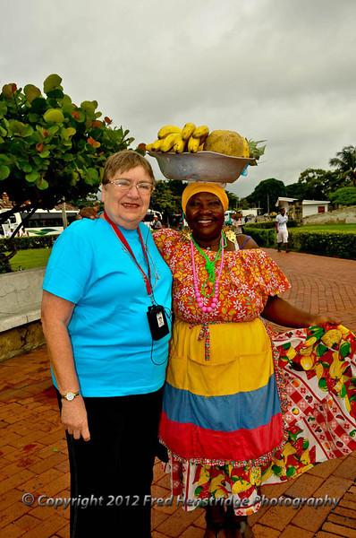 Kathy with the fruit seller at the Castillo de San Felipe de Barajas, Cartagena