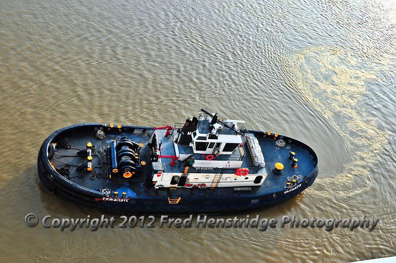 Tug along side our ship