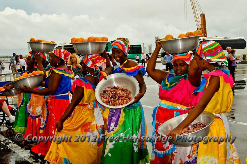 Welcoming girls at the Cartagena pier