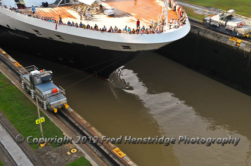 Holland America ship being towed through the lock by mules