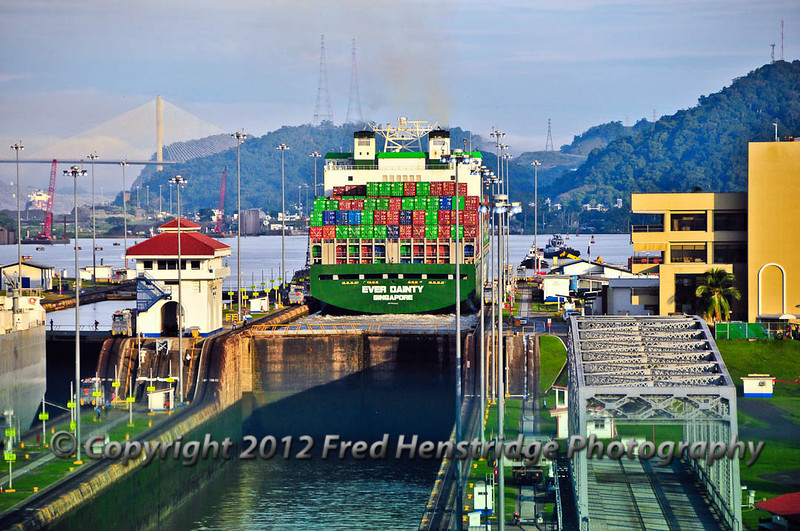 Container ship in the Miraflores locks after being raised the full 54 feet by the two stages of the Miraflores Locks