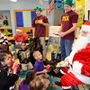 J.S.CARRAS/THE RECORD as members of RPI fraternity Pi Kappa Alpha (PIKES) deliver Christmas gifts to students at P.S. 2  Monday, December 9, 2013 on Tenth Street in Troy, N.Y..