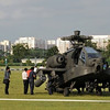 A Republic of Singapore Air Force Apache AH-64 helicopter sits on the field with its tail (rear L) detached after it crashed-landed in Singapore on September 30, 2010.  The Apache helicopter crash-landed at an open field within a residential district on September 30, afternoon but no one was injured in the incident, the defence ministry said.  The Apache AH-64, built by US aviation giant Boeing, is a four-blade, twin-engine attack helicopter, and is used by the US, Israeli and Japanese militaries, among others.          AFP PHOTO/ROSLAN RAHMAN (Photo credit should read ROSLAN RAHMAN/AFP/Getty Images)