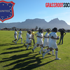 Team practicing in front of Table Mountain.  RV United and Grassroot Soccer logos included.