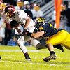 Don Knight/The Herald Bulletin<br /> Shenandoah's Cody Rudy tackles Scecina's Rocky Leffler during the sectional championship on Friday.