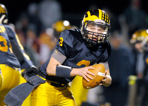 Don Knight/The Herald Bulletin<br /> Shenandoah quarterback Adam Lovan drops back as the Raiders hosted the Scecina Crusaders for the sectional championship on Friday.