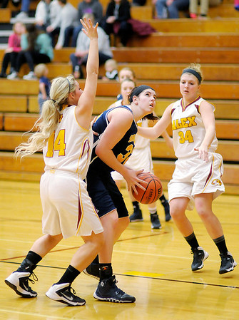 Don Knight / The Herald Bulletin<br /> Shenandoah's Rachel Krathwohl looks to shoot as she is guarded by Alexandria's Kennedy Aiman on Saturday.