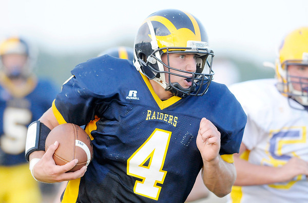 Don Knight/The Herald Bulletin<br /> Shenandoah's Lane Young returns an interception 41 yards for a touchdown as the Raiders hosted Hagerstown on Friday.