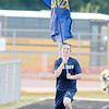 Don Knight/The Herald Bulletin<br /> Shenandoah Blue Crew member Brayden Crow, 16, runs down the track carrying a Shenandoah flag after the Raiders scored a touchdown as they opened their season at home against Hagerstown on Friday.