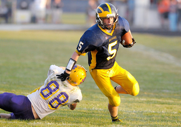 Don Knight/The Herald Bulletin<br /> Shenandoah's JJ Myers evades Hagerstown's Austin Durham on a run to the outside as the Raiders hosted the Tigers on Friday.