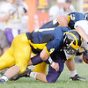 Don Knight/The Herald Bulletin<br /> Shenandoah's Lane Young (4) and Carson Powell (52) tackle Hagerstown running back Clayton Barber as the Raiders hosted the Tigers on Friday.