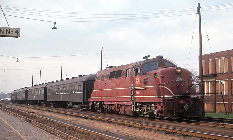 Rock Island BL2 #426 pulling a commuter train.