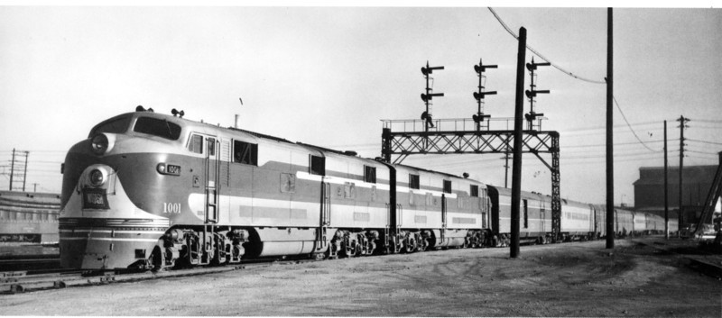 """Wabash E7A's 1001/1001A bring 11-car """"City of St. Louis"""" into Denver on November 1, 1947.  Photo by R. H. Kindig."""
