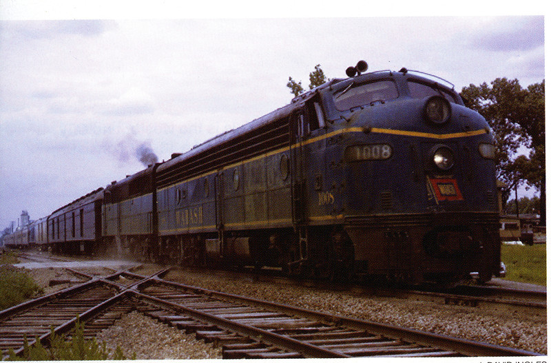 """Wabash E8 #1008 and PA #1052 on the eastbound """"City of St. Louis"""" at the Katy diamond leaving Moberly, MO on May 30, 1964.  Photo by J. David Ingles."""