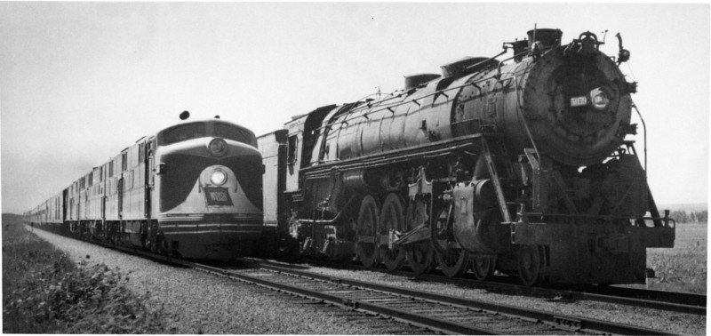 """Wabash E7a's, spliced by a UP B Unit on the """"City of St. Louis"""" overtake a Rock Island 484 freight outside Limon,CO in 1949."""