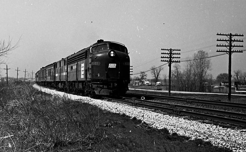 A Penn-Central E-Unit leads a passenger train past St. Jacob, IL.<br /> (Photo by William A. Shaffer)