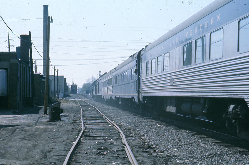 """Two coaches are behind the diner and I recognize them for what they are.  The first was originally used on the """"City of St. Louis"""" while the next coach, with its fluted silver sides, was a Nickel Plate Road coach.<br /> (Photo by William A. Shaffer)"""