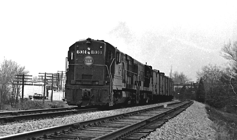 N&W #1930, a GE U25B, is shown traveling northbound past the campus of Millikin University.<br /> (Photo by William A. Shaffer)