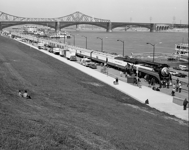 """American Freedom Train (circa April, 1976)<br /> The American Freedom Train was on display in St. Louis during April, 1976.  It is shown displayed on the St. Louis Riverfront with various ships and bridges in the background.  The most famous ship in the photograph is the one on the left side of the photo.  That was the """"S.S. Admiral"""" which plied the Mississippi River for many years.  The bridges shown are the Eads Bridge and behind it, the Veterans Bridge, now Martin Luther King Bridge.<br /> (Photo by William A. Shaffer)"""