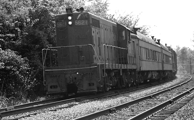 Peoria & Eastern #5621 is shown with a work train in tow on the Pennsylvania Railroad south of Troy, IL.<br /> (Photo by William A. Shaffer)