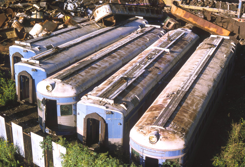 Eight lightweight streamlined M.U. Cars were built for IllinoisTerminal by St. Louis Car Company in 1948.  These became the backbone of IT's streamliner fleet.  The service lasted to 1955, when the equipment was sent to the scrap yard.  I photographed this equipment in the mid 1970s, where it still sat in the scrap yard.  Shortly after these photos were taken, the equipment disappeared, probably crushed for scrap.<br /> (Photo by William A. Shaffer)