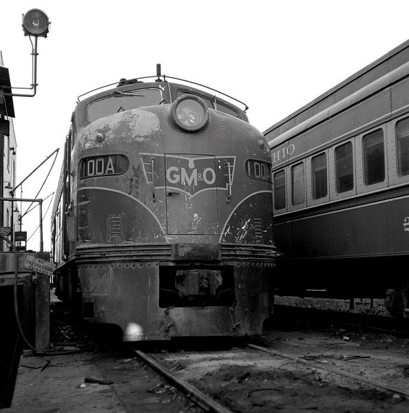 """GM&O #100A began life in June, 1937 as EMD E-3 Locomotive #50 of the Baltimore & Ohio Railroad.  It was the original motive power for B&O's famous """"Royal Blue"""" passenger train.  Sometime during the 930s, the locomotive was sent to the Alton Railroad (which at that time was under B&O control) and it became Alton 100A.  When the merger with the GM&N went through, the locomotive became GM&O #100A.  In 1953, it was sent back to EMD and rebuilt to an E8Am and returned to the GM&O.  At some later date, the locomotive was renumbered to #100.<br /> (Photo by William A. Shaffer)"""