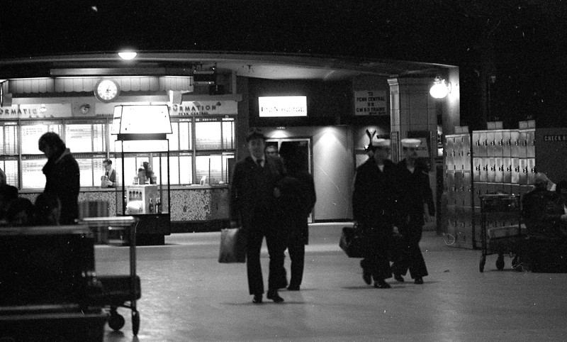 Interior of Dearborn Station (circa January, 1971) shows passengers strolling through the terminal.  The depot had always been small and this photo shows how dim the lighting could be.<br /> (Photo by William A. Shaffer)