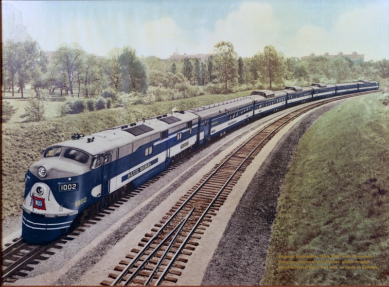 """Wabash """"Blue Bird"""" (Circa 1950) is shown in this company publicity photo in Forest Park - St. Louis, MO.  The train began service on February 26, 1950 and continued in operation until 1970, when it was discontinued by Norfolk & Western and replaced with the """"City of Decatur"""".  The """"Blue Bird"""" was the only passenger train to operate between St. Louis and Chicago which had regularly scheduled dome cars in its consist, on both Pullman and coaches.<br /> (Company Photograph for the Wabash Railway Company - Photographer Unknown)"""