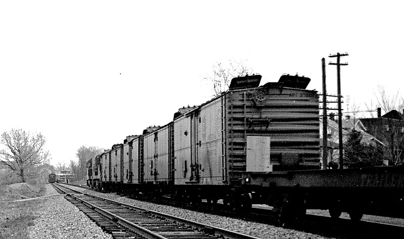 This freight train has just passed by Millikin University with the hatches up on some of the older Fruit Growers Express cars.<br /> (Photo by William A. Shaffer)