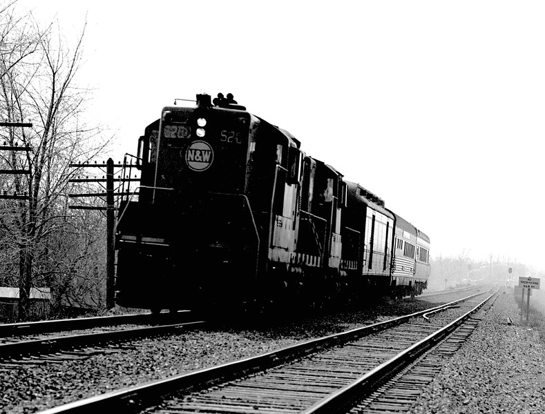 """N&W #520 is shown with the northbound """"Blue Bird"""", train #124, as it races to the depot in Decatur, IL.<br /> (Photo by William A. Shaffer)"""