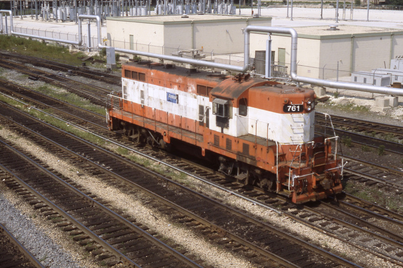"""A former Frisco GP is shown in Amtrak switching service in Chicago Yards.  The locomotives were referred to as """"Pumpkins"""" because of their color scheme!<br /> (Photo by William A. Shaffer)"""