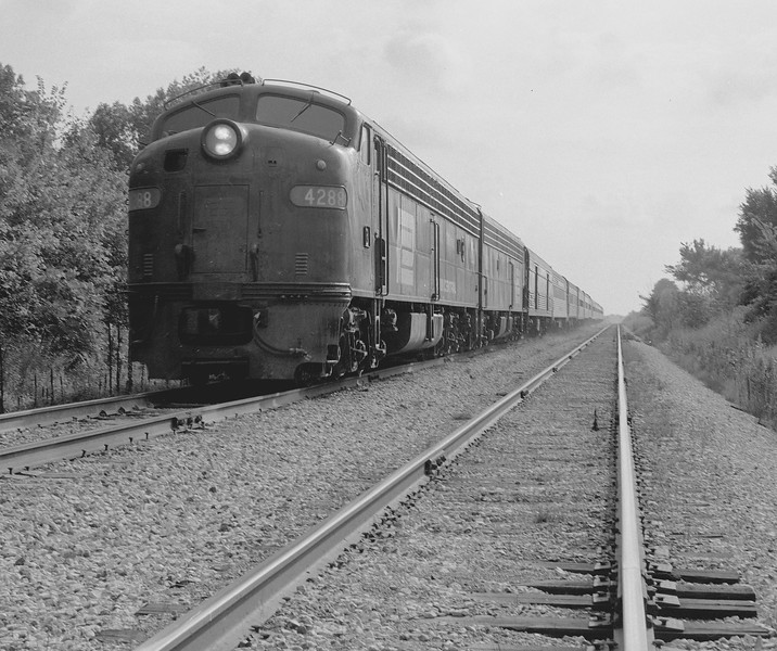 """Penn-Central #4288 has the """"National Limited' in tow south of Troy, IL.<br /> (Photo by William A. Shaffer)"""