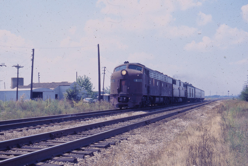 A Pennsylvania Railroad passenger train speeds by St. Jacob, IL on its way to points east!<br /> (Photo by William A. Shaffer)