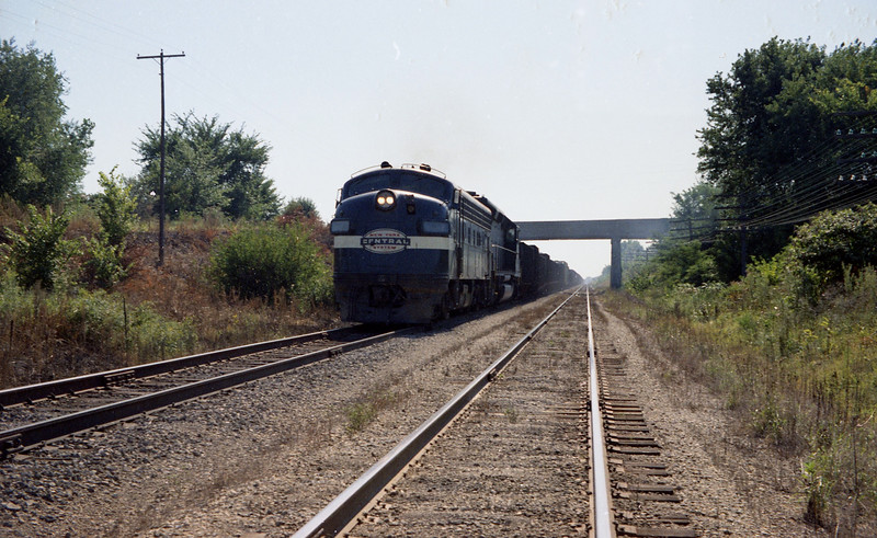 A New York Central F-Unit has a Penn-Central freight train in tow near Troy, IL.<br /> (Photo by William A. Shaffer)