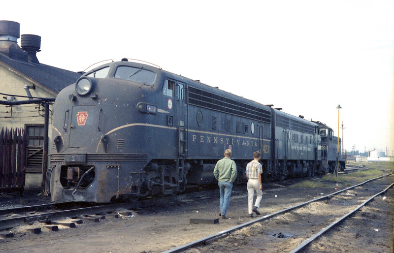 A Pennsylvania F-Unit is coupled to a New York Central F-Unit at Rose Lake Yard in E. St. Louis, IL.  The two boys in the photograph are (L to R) Michael Klaus and James R. Klaus.<br /> (Photo by William A. Shaffer)