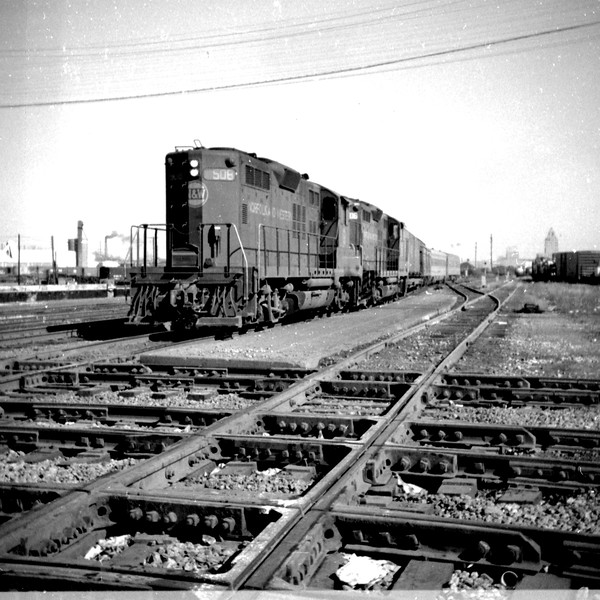 """N&W #508 brings a southbound """"Wabash Cannon Ball"""" into Decatur, IL.  It is approaching the Illinois Central diamond at Wabic Tower.<br /> (Photo by William A. Shaffer)"""