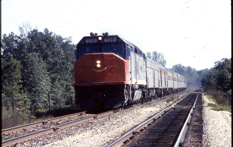 """Amtrak SDP40F #598 is shown on the head end of the """"National Limited"""" near Troy, IL.<br /> (Photo by William A. Shaffer)"""